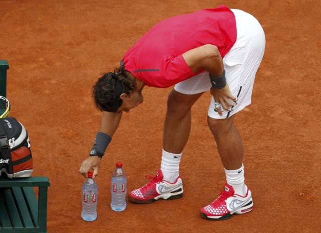 Nadal of Spain arranges bottles near his chair on the court during his quarter-final match against his compatriot Almagro at the French Open tennis tournament at the Roland Garros stadium in Paris